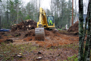 A excavator used to grub of a building lot