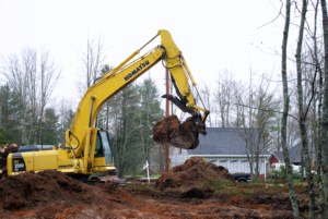 A excatator used to pull tree stumps and grub a building lot