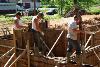 Men pouring a concrete foundation