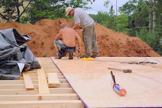 A picture of 3/4 in. osb board being laid.