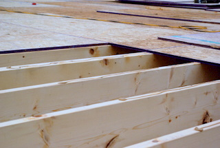A picture of 3/4 t&g osb board on a first floor.
