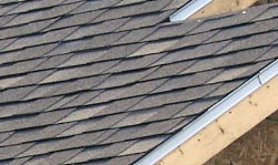 A picture of  architectural shingles on a roof.