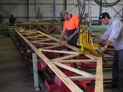 Roof trusses being built in a factory