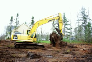 Prepairing a building lot for a foundation with the aid of a excavator
