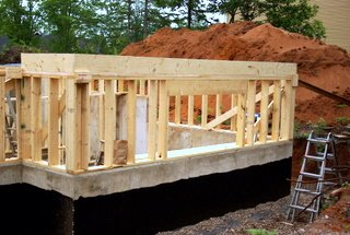 A picture showing a pony wall and a rim joist.